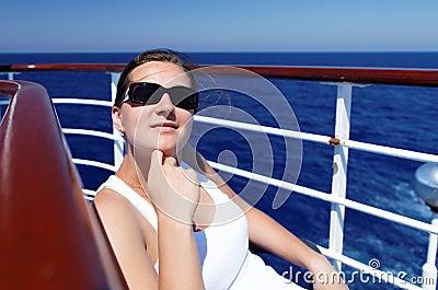 A girl in glasses enjoys clean air