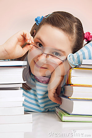 Girl with glasses and a lot of books