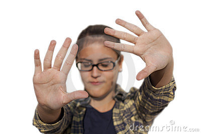 Girl with glasses puts her hands out to protect