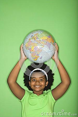 Girl with globe on head.