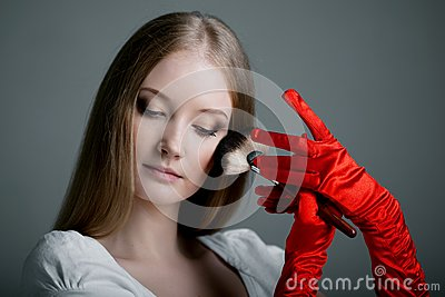 Girl in gloves with brush
