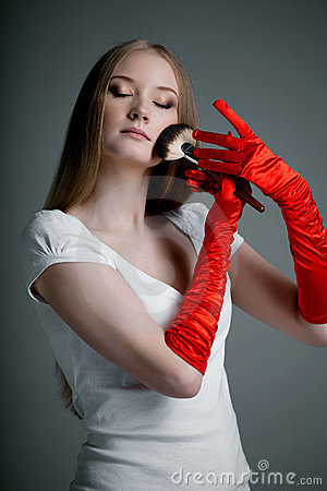 Girl in gloves with brush