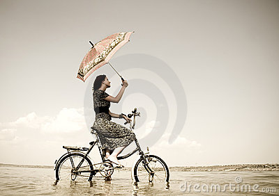 Girl go for a cycle ride at water