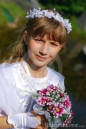 Girl going to the first holy communion in sepia