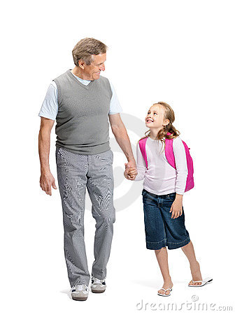 Girl going to school with her grandfather