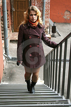 A girl going up stairways