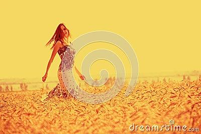 Girl in golden cornfield