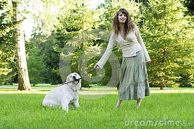 Girl with the golden retriever in the park