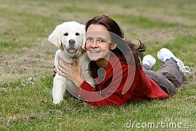 Girl with golden retriever puppy