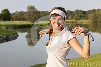 Girl golf player on golf course.