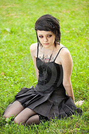 Girl in gothic style on grass
