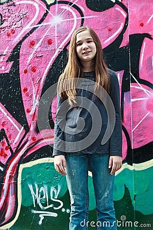 Girl by a grafitti wall