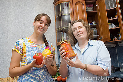 Girl and grandma holding pepper and jam
