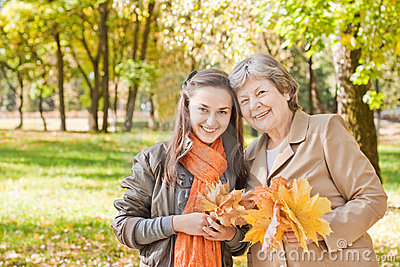 Girl with grandmother in autumn park