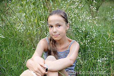 Girl on grass background
