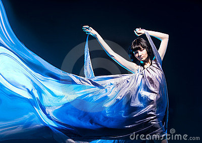 Girl in a gray dress flying with blue backlight