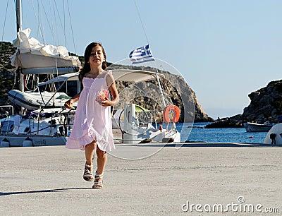 Girl in Greek harbor