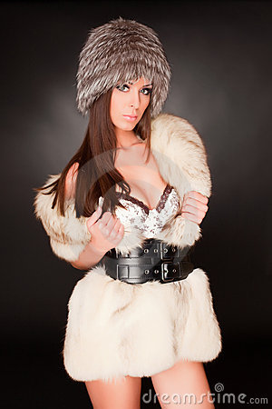 Girl with green eyes in furry hat