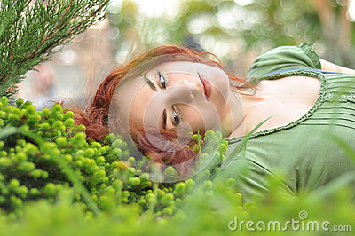 Girl on a green meadow
