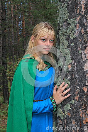 The girl in the green raincoat, nestled on a pine