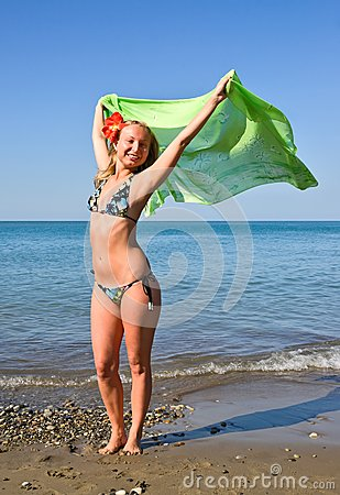 Girl with green scarf on beach