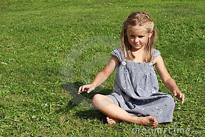 Girl in grey dress concentrating