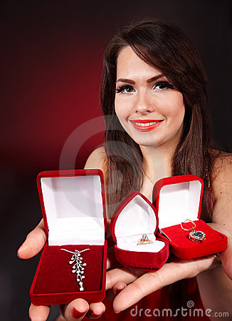 Girl with group jewellery box on red background.