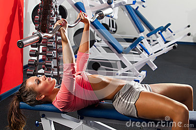 Girl in gym Bar Bench Press