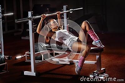 Girl in gym Bar Bench Press