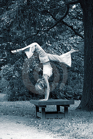 Girl gymnast in park
