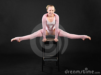 Girl gymnast took graceful pose at stool