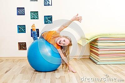 Girl on a gymnastic ball