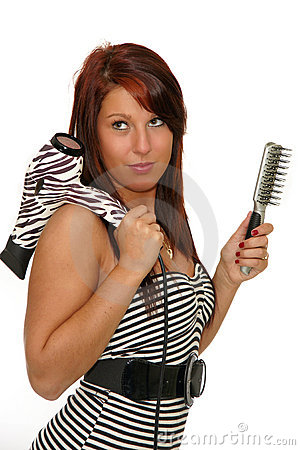 Girl with hair dryer and brush