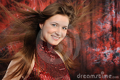 Girl with hair fluttering in the wind