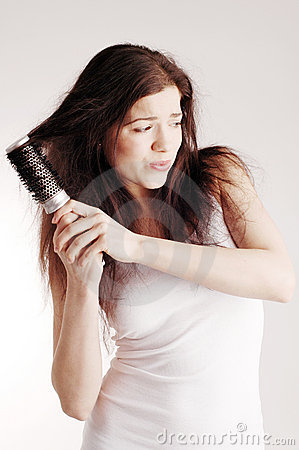 Girl with hairbrush, hair problems