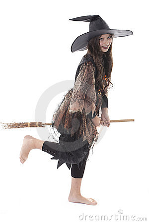 Girl on halloween costume and broom