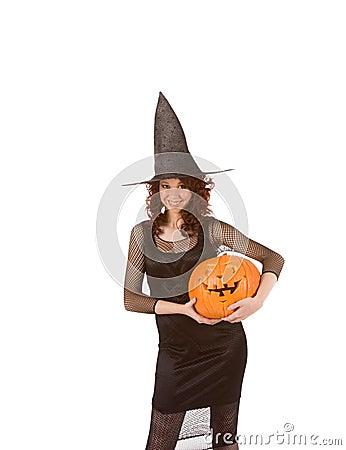 Girl in Halloween costume (focus on pumpkin