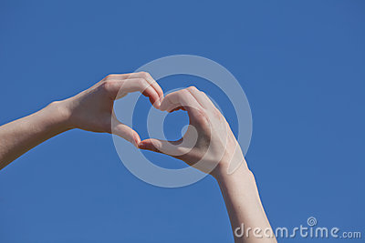 Girl hand in heart form
