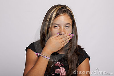 Girl with hand over her mouth