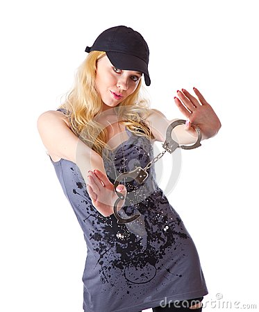 A girl with handcuffs in hands