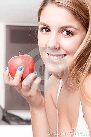 Girl happy relaxed with an apple