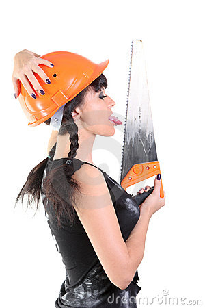 Girl in hard hat licks a saw