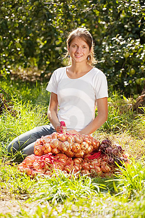 Girl with harvested onion