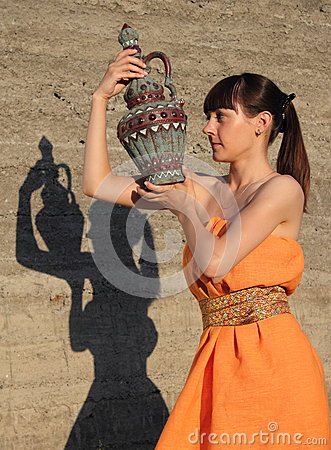 The girl has control over a jug