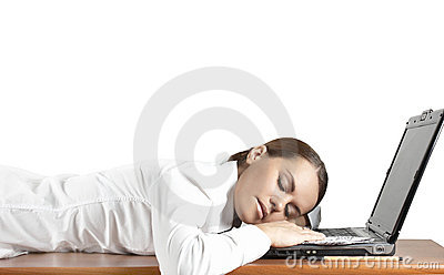 Girl has fallen asleep behind the computer