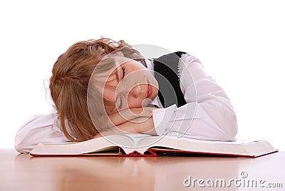 Girl has fallen asleep near the book