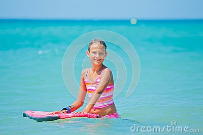 Girl has fun with the surfboard