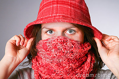 Girl has muffled in a scarf.