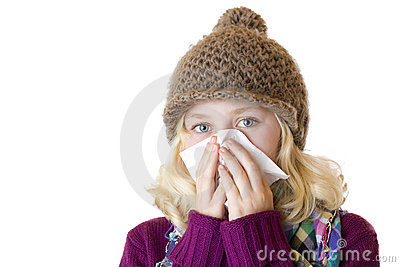 Girl has sniff and blow her nose with a tissue