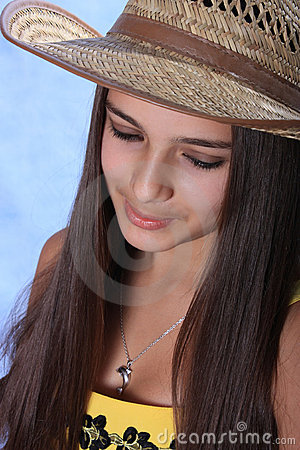 The girl in a hat of the cowboy.